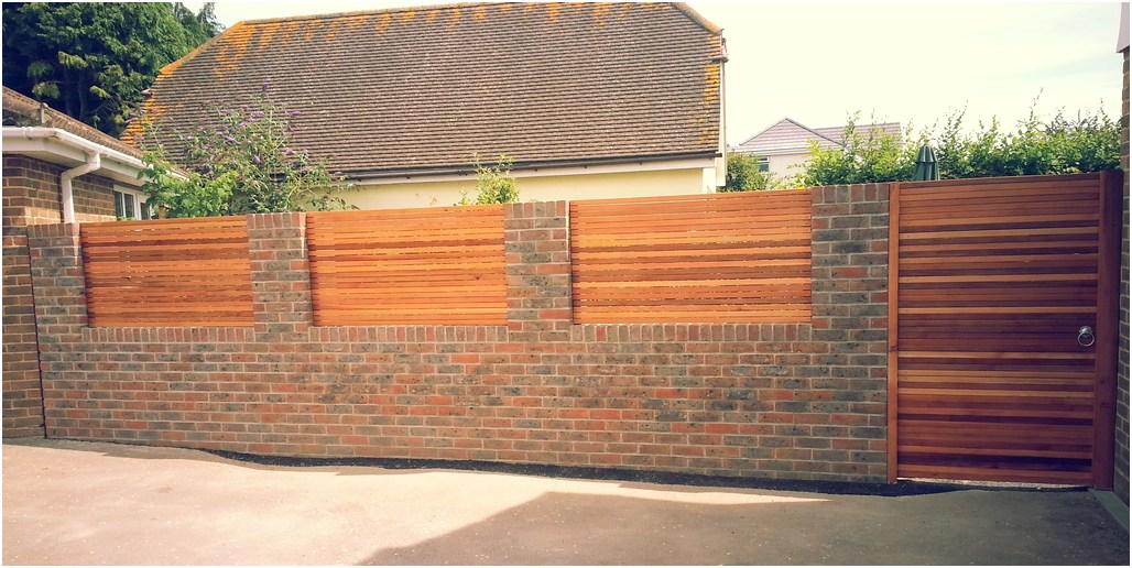 desain tembok pagar rumah minimalis batu alam batu bata kayu klasik elegan mewah modern terbaru